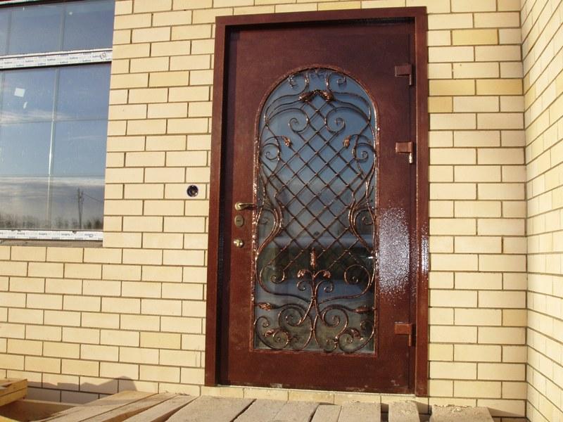 двери входные стекло с ковка